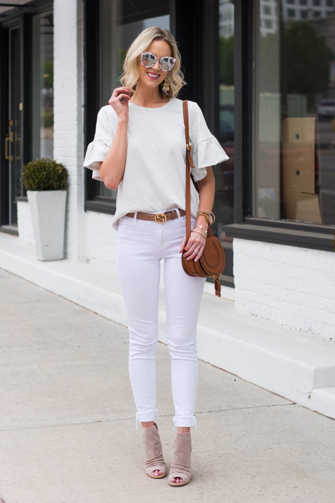 post sharing how to style white jeans during the spring season