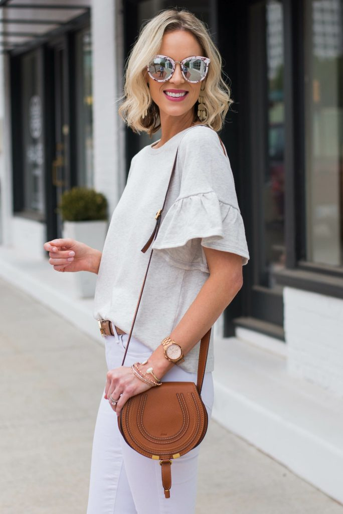cute flutter sleeve sweatshirt top perfect for spring with chloe bag