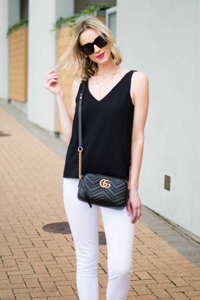 black tank with gold accessories and black gucci bag