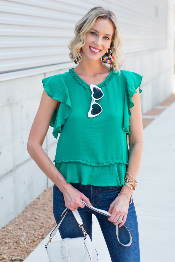 dressy green top with statement rainbow earrings