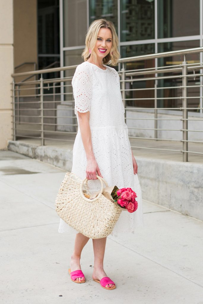 beautiful spring outfit with white dress, pink roses, and pink shoes