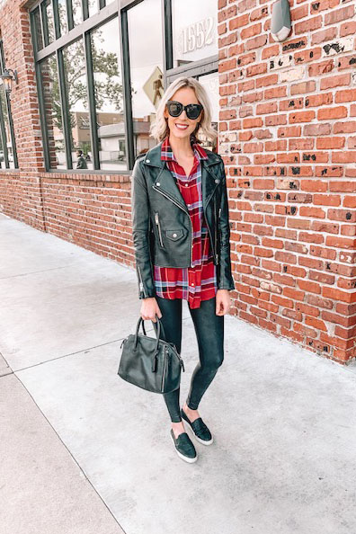 how to wear leggings casually; faux leather leggings with a long plaid top and leather moto jacket