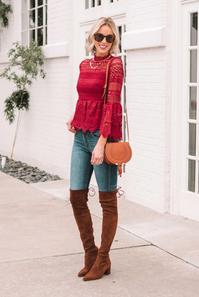 beautiful deep berry colored lace peplum blouse paired with brown suede over the knee boots