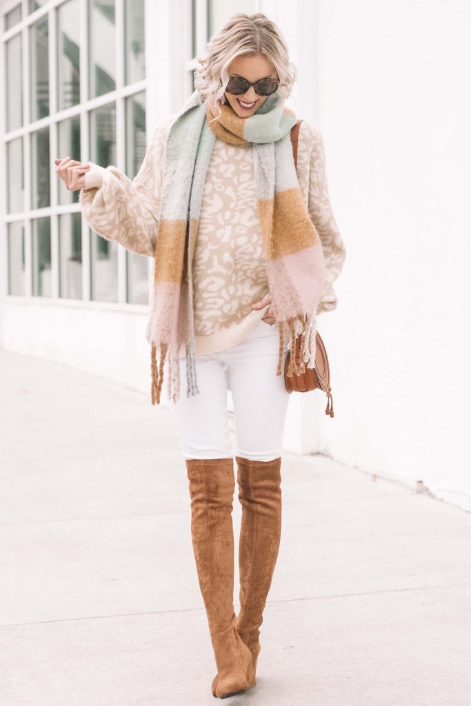 neutral leopard sweater styled with white jeans and camel over the knee boots