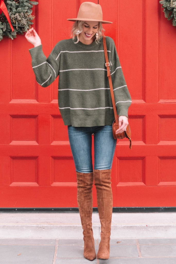 festive holiday outfit, green sweater with camel colored over the knee boots