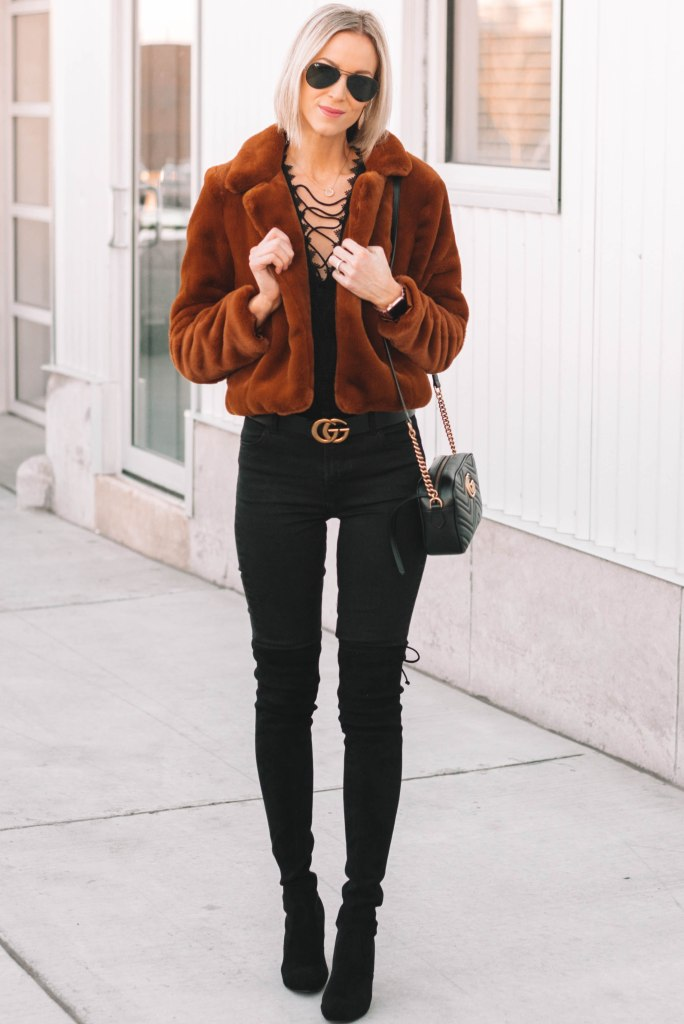 all black outfit, black jeans, black heeled over the knee boots, brown faux fur coat