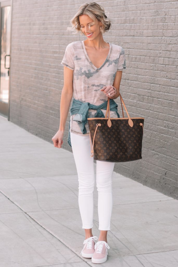 Want to define your waist without the bulk of a jean jacket? Try tying a chambray shirt around your waist!