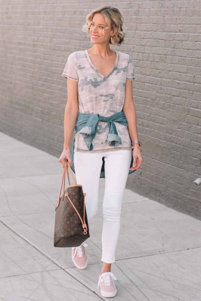 camo t-shirt, chambray top tied at waist, white jeans