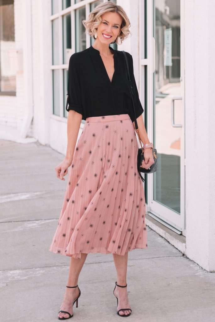 blush pleated midi skirt with black top, dressy work outfit