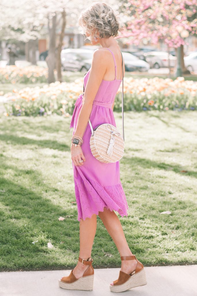 cute straw circle bag with purple midi dress and wedges