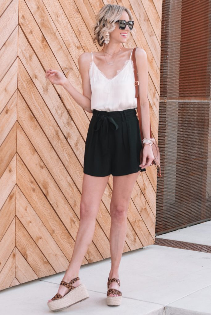black paperbag waist shorts styled with a lace cami