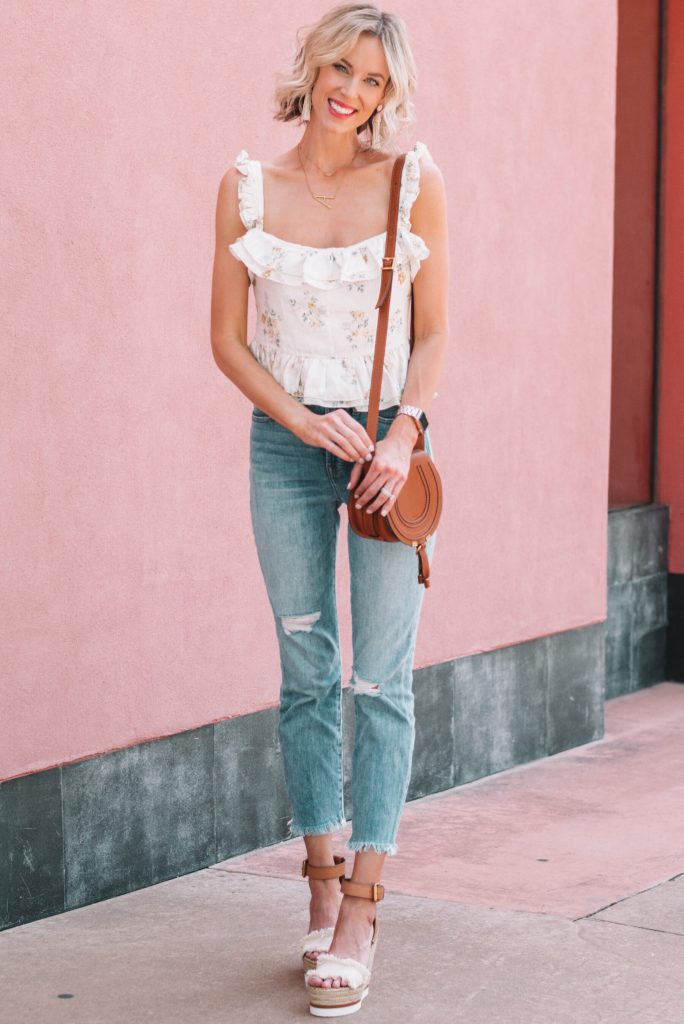 adorable white floral tank top and jeans for spring date night idea