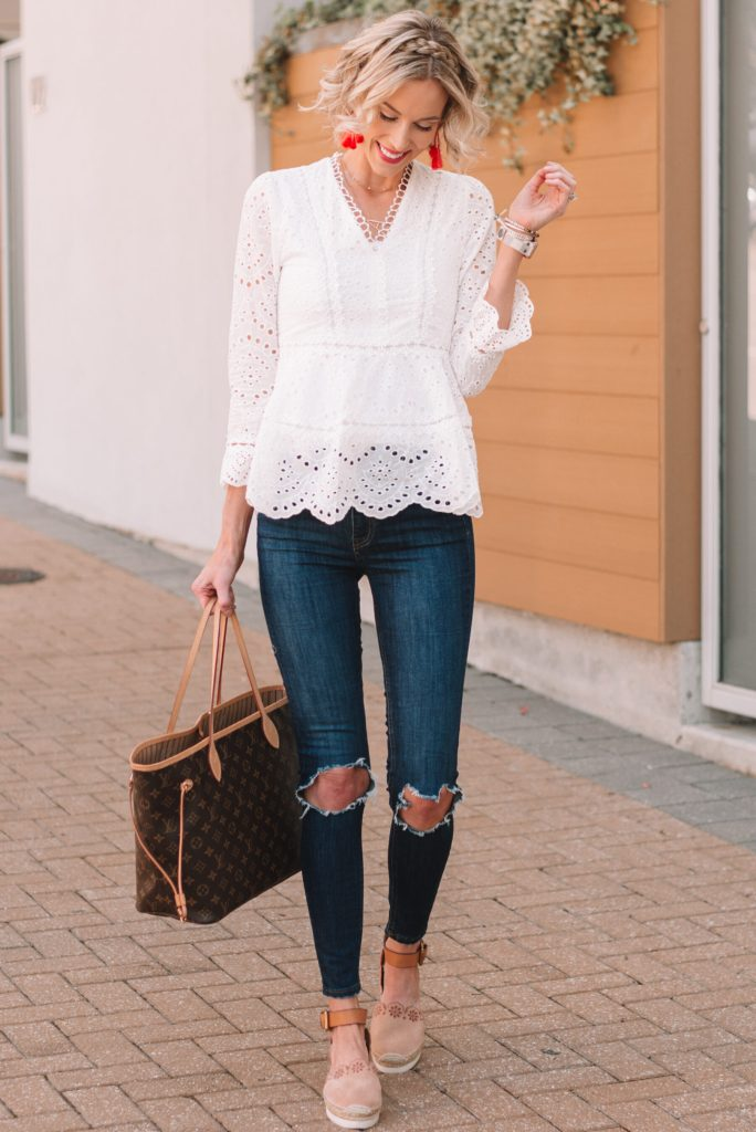 white eyelet blouse worn with busted knee skinny jeans