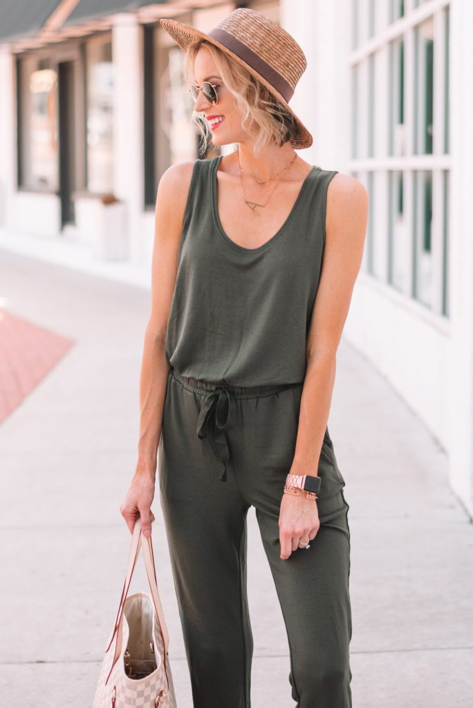 straw hat with jumpsuit and gold jewelry