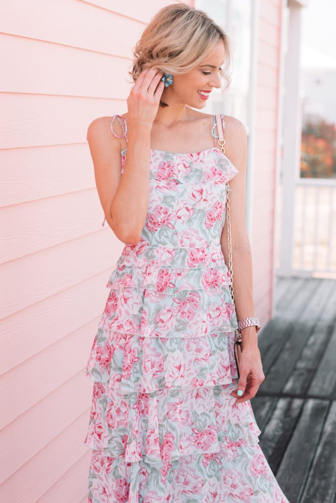 blue and pink floral dress with blue floral earrings