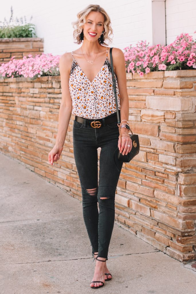 leopard tank top and black jeans for edgy summer date night outfit