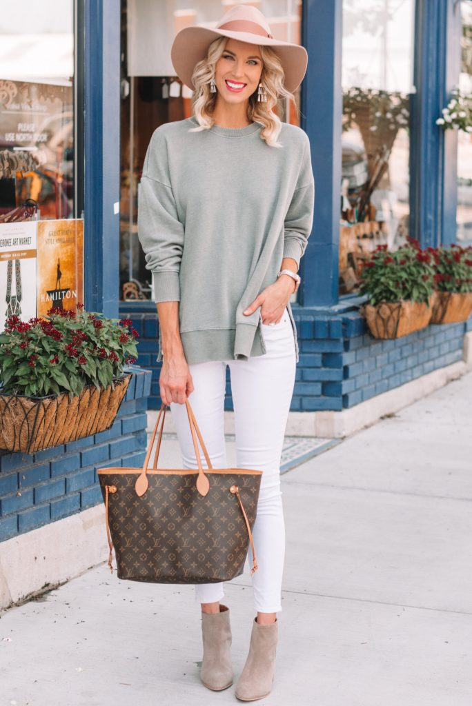 side slit pullover with white jeans and boots, cozy fall outfit, neutral fall outfit