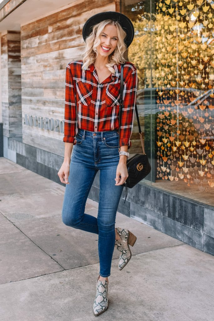 orange colored fall flannel, snake boots, skinny jeans