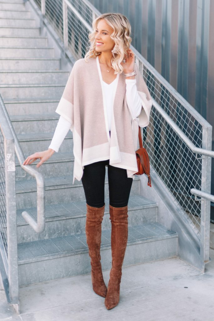 Neutral Poncho Wrap 4 Ways, black jeans with white t-shirt, over the knee boots, and poncho wrap sweater