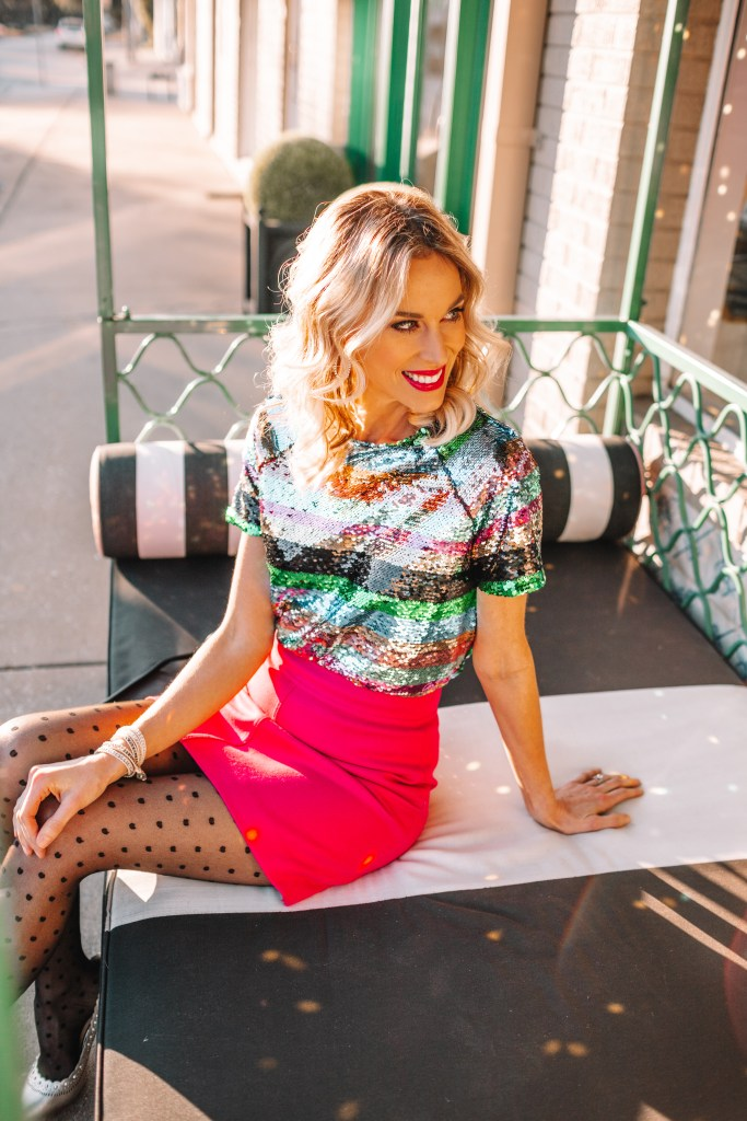 gorgeous sequin top for the holidays, pink mini skirt, what to wear for the holidays if you don't want to wear red, polka dot tights