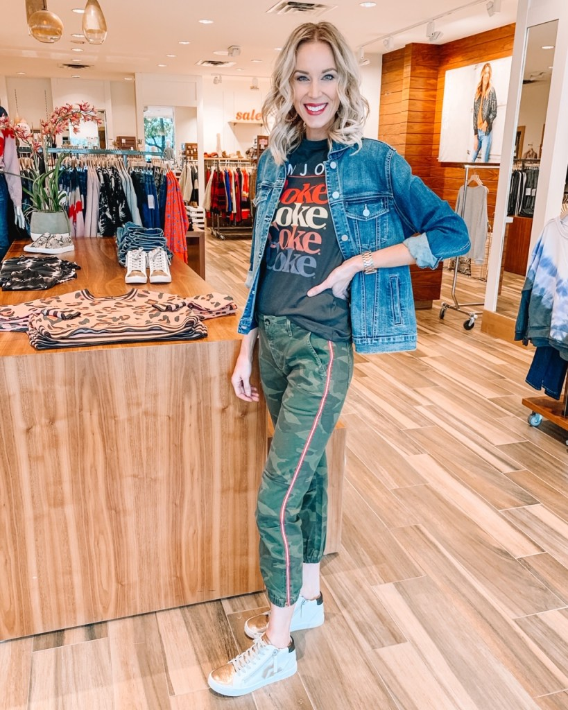camo joggers with a stripe, graphic t-shirt, jean jacket