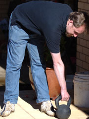 Compound kettlebell stiff-legged deadlift