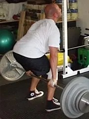 Nate Dogg performing the Hack Squat - image via T-Nation