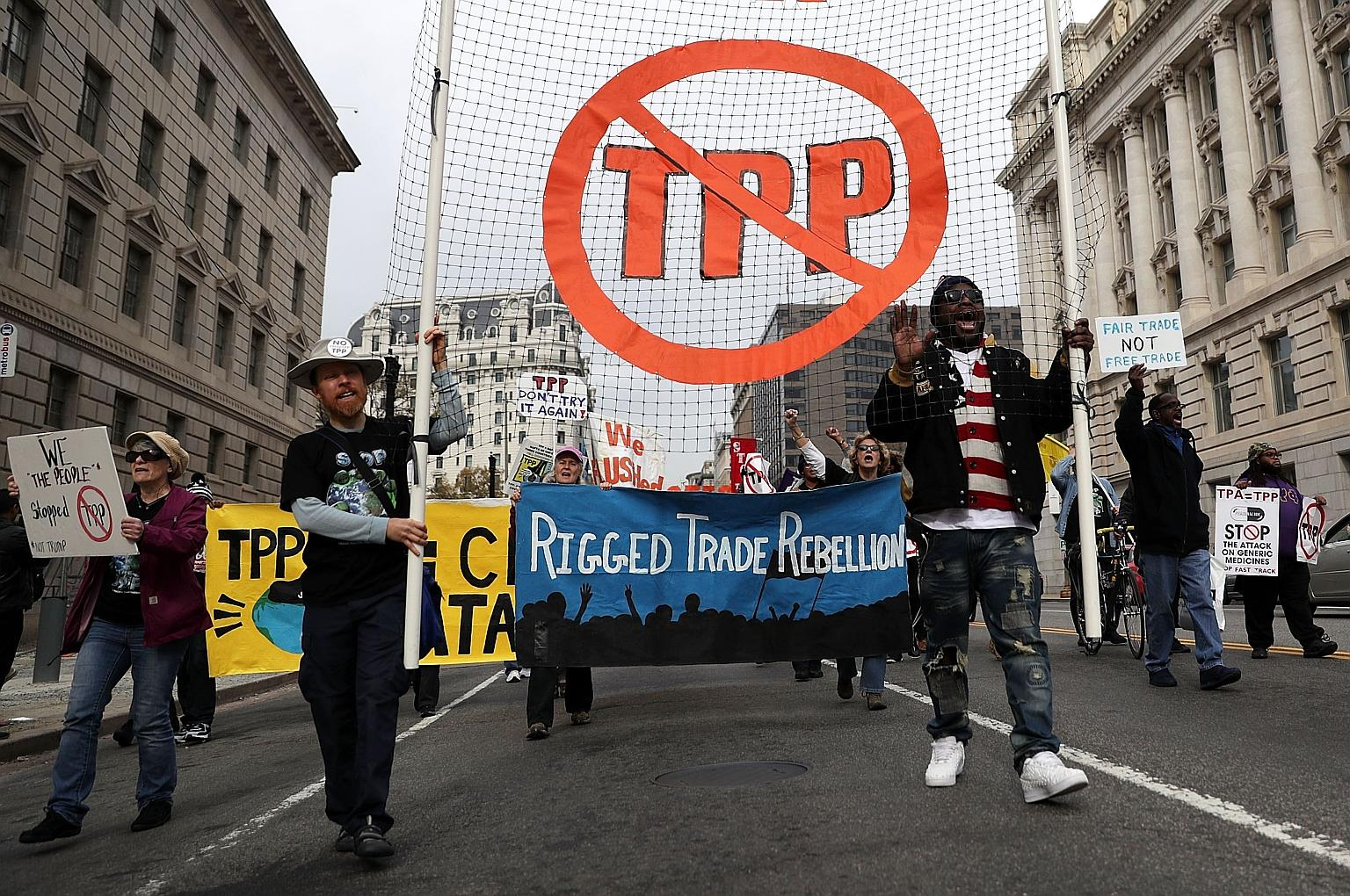 Protesters marching in an anti-TPP rally in Washington, DC last month.