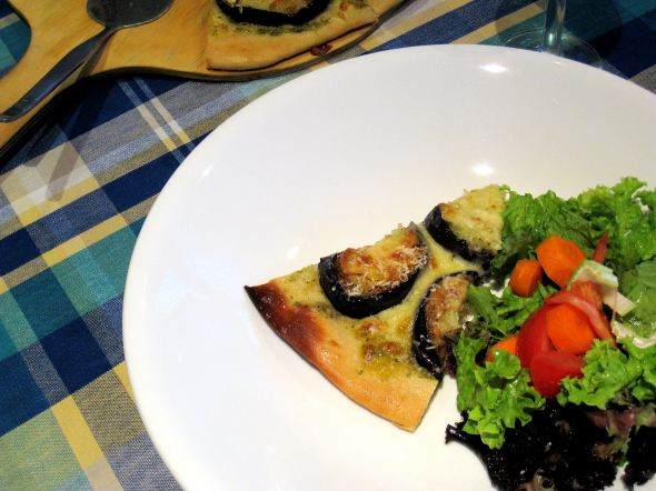 Eggplant and pesto pizza with salad
