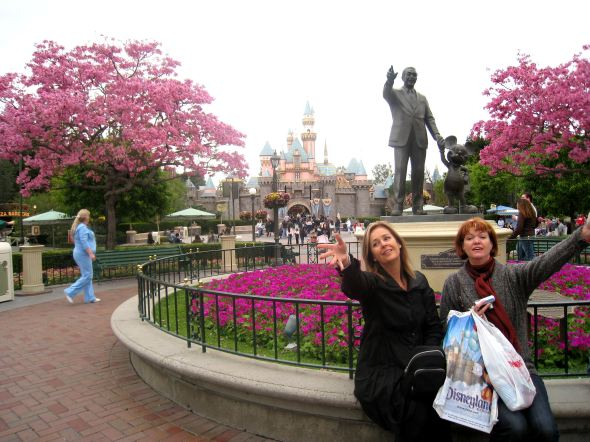 My sister and friend at the entrance to Fantasyland