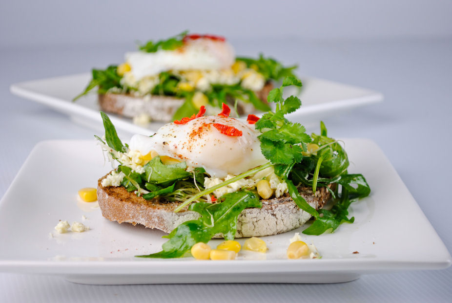 Goat cheese, arugula and poached egg open sandwich