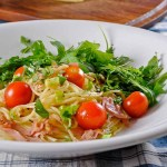 Pasta with ham, cherry tomatoes & arugula