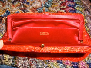 Inside the red Saks purse