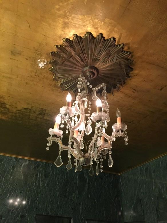 I. Magnin bathroom: gold-leafed ceiling and crystal chandelier