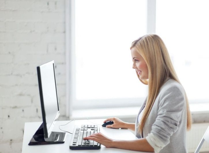 19857134 - picture of smiling businesswoman with computer in office