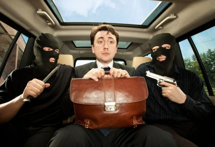 10115585 - robbery, businessman grasped in hostages.