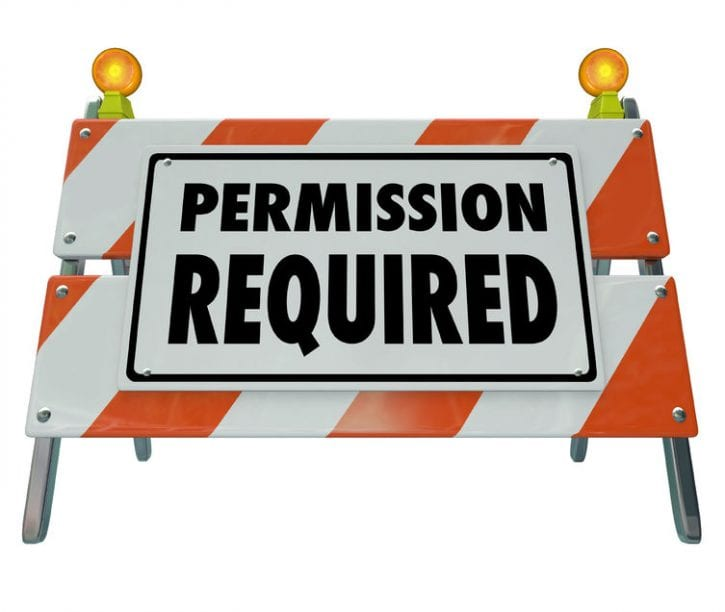 43224992 - permission required sign or barrier blocking access to area or exclusive event where admission is checked and approved