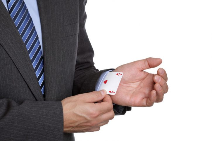 25395391 - business sayings ace up his sleeve magic trick or cheating in card game