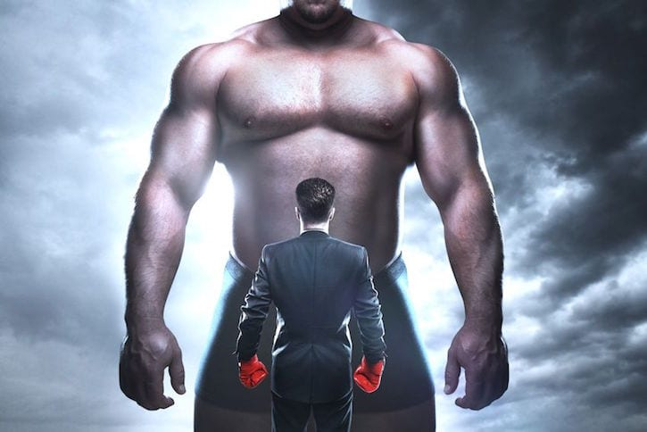 20280435 - businessman boxing against a big muscular man