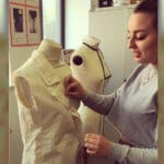 Student pinning dressmakers mannequin