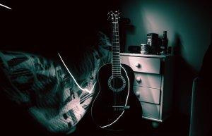 guitar bedroom music practice. Practising music in the dark is not ideal.
