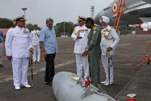 Defence Minister Manohar Parikkar being briefed by Captain Theophilis, Commanding Officer INAS 303 about MiG-29K fighter aircraft, at INS Hansa last week | Photo: PIB