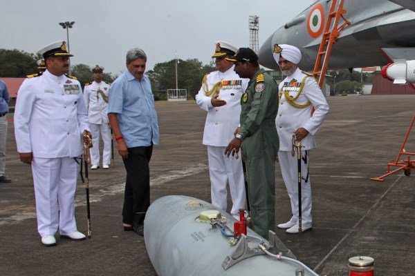 Defense Minister Manohar Parikkar being briefed by Captain Theophilis, Commanding Officer INAS 303 about MiG-29K fighter aircraft, at INS Hansa last week | Photo: PIB