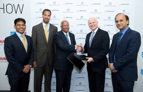 Boeing India President Pratyush Kumar, Boeing International President, Marc Allen, Tata Advanced Systems Chairman S. Ramadorai and Tom Bell, senior vice president, Global Sales & Marketing, Boeing Defense, Space & Security and Tata Advanced Systems CEO Sukaran Singh at the signing ceremony.