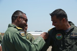 INAS 300 CO Commander Shikku Raj sticks the 500-hour patch on Lieutenant Commander Patil after this sortie on Tuesday | Photo: StratPost
