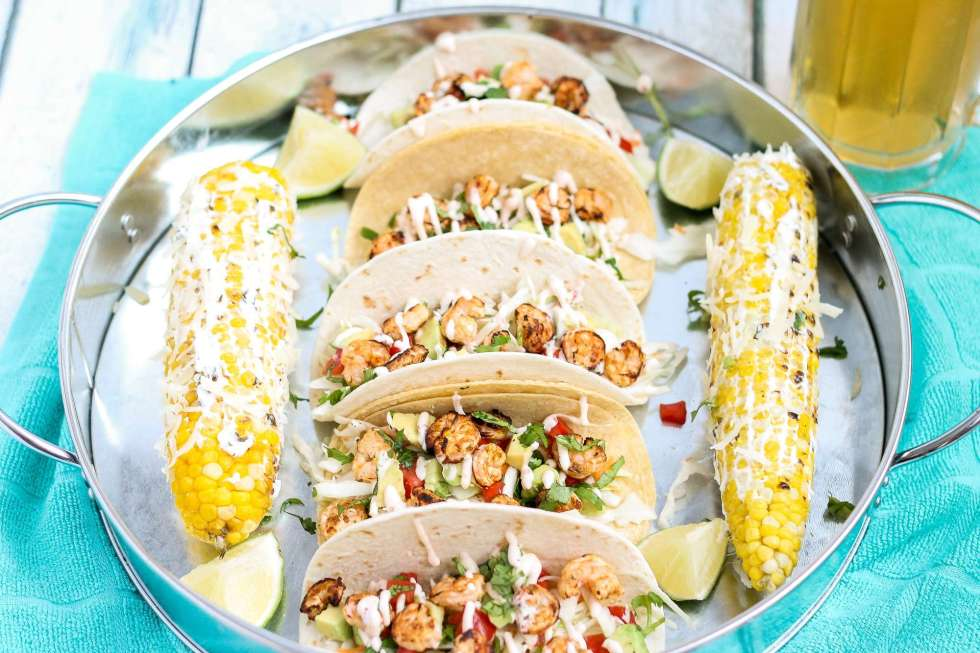 These Grilled Shrimp Tacos are deliciously easy, fun and packed with bright citrus flavor. Topped with a chipotle lime sauce and these babies are taken to a whole other level. Throw the shrimp on the grill for a delicious charred flavor and you've got yourself a quick summer meal perfect for any time of the day. | Strawberry Blondie Kitchen