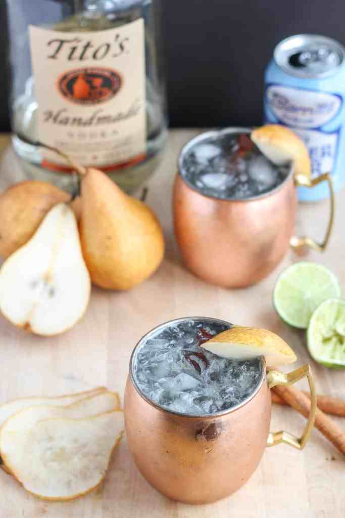 The perfect fall cocktail, this Spiced Pear Moscow Mule features spiced pear simple syrup, vodka, lime and ginger beer. It'll have you enjoying the flavors of Autumn sip after sip. | Strawberry Blondie Kitchen