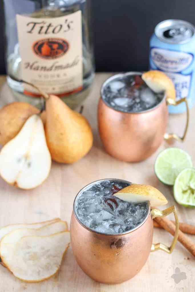 The perfect fall cocktail, this Spiced Pear Moscow Mule features spiced pear simple syrup, vodka, lime and ginger beer. It'll have you enjoying the flavors of Autumn sip after sip   Strawberry Blondie Kitchen