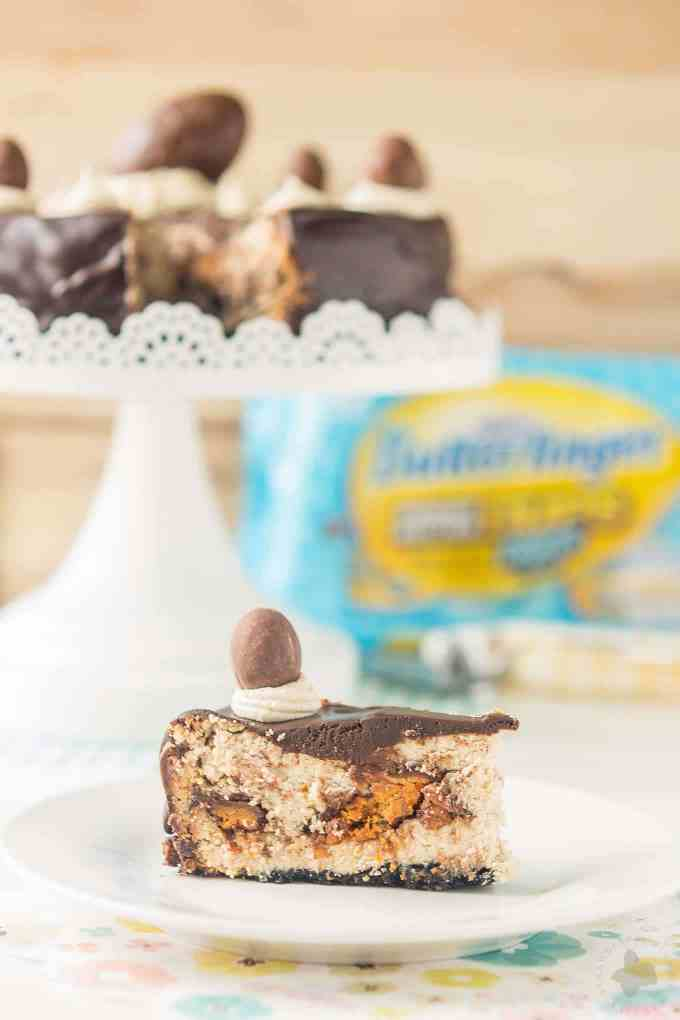 Layers of chocolate cookie crust, peanut butter cheesecake, BUTTERFINGER® Cup Eggs, chocolate ganache and peanut butter frosting, this BUTTERFINGER® Cheesecake Pie is a peanut butter lovers dream! | Strawberry Blondie Kitchen
