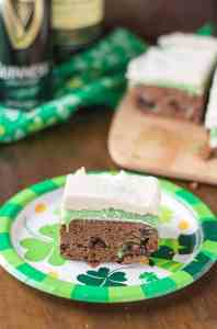 Guinness Stout Chocolate Brownies, Jameson White Chocolate Ganache and Bailey's Buttercream frosting are what these Irish Car Bomb Brownies are made of! Decadently sweet, these brownies will satisfy any sweet tooth, even those who aren't lucky enough to be Irish! | Strawberry Blondie Kitchen